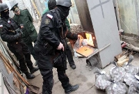 Russian Federal Drug Control Service officers burn bags of synthetic opioid Methadone during an operation in in Simferopol on December 23, 2014